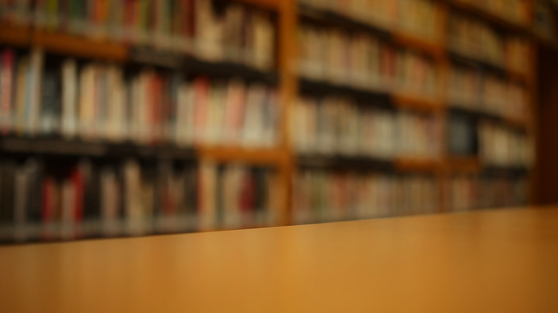 on-the-table-at-library-blurred-background_b0oedgtjl_thumbnail-full01